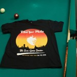 Vibe for Philo printed t-shirt resting on a pool table with a cue and seven ball