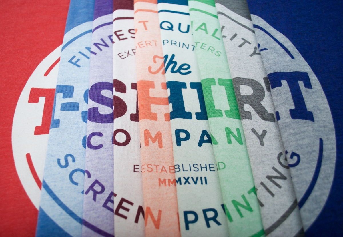 Bella and Canvas tri-blend t-shirts in eight colours with a white water based discharge ink screen print of The T-Shirt Company's Logo